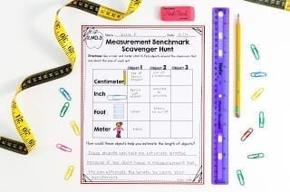 Rulers with worksheet showing centimeter, inch, foot, and meters