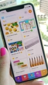 Image of a woman holding a cell phone showing free school supplies on the ClassTag Parent-Teacher app.