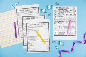 Context Clues Activities and anchor chart with colored pencils and a purple ribbon