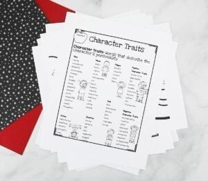 Character traits worksheet in black in white with colored paper behind it.